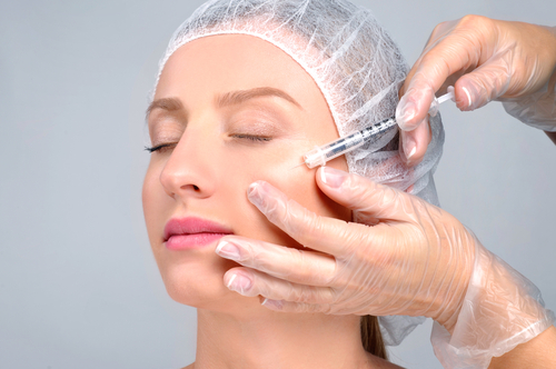 Woman is getting filler injection in cheeks-img-blog