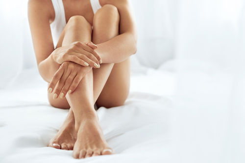 close up of Long female legs with perfect smooth soft skin, pedicure and beautiful hands with natural manicure-img-blog