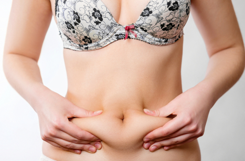 girl squeezes her stomach, girl squeezes fat on her stomach, fatty folds on the abdomen-img-blog