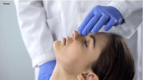 Doctor examining patient nose after rhinoplasty surgery-img-blog