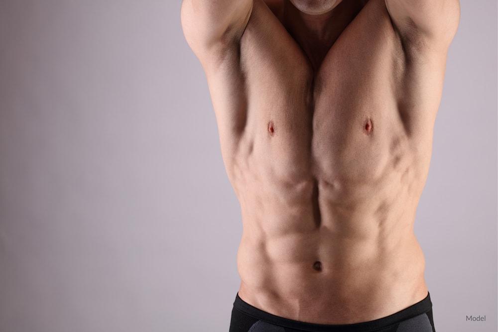 Man posing without body hair.