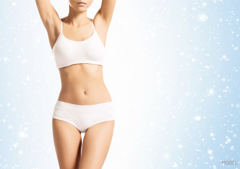 Woman's body wearing white underwear against a background with the look of snowflakes.